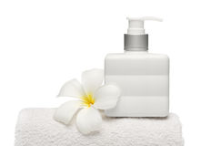 Square bottle soap and flower on white towel white background Stock Photo