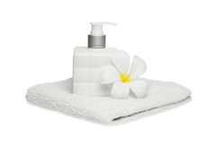 Square bottle soap and flower on white towel white background Royalty Free Stock Photos