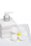 Square bottle soap and flower on white towel white background Stock Images