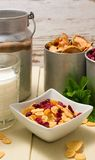Square bowl with cornflakes and old can plus cups in background Stock Photography