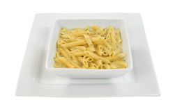Square bowl of pasta on square plate Stock Photography