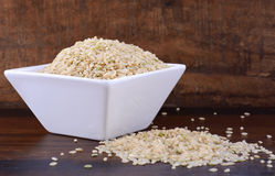Square bowl of uncooked rice Royalty Free Stock Photo