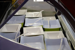 Square bowls in cabinet Stock Photography