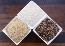 Square bowls of uncooked rice Royalty Free Stock Photography
