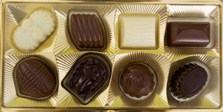 Square box of chocolates over white. Royalty Free Stock Photography
