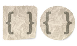 Square brackets. Crumpled slip of paper and a square brackets Stock Photo