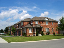 Square brick houses. Rows and rows of brick homes which look very similar to each other, in Ontario, Canada Stock Photos