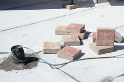 Square bricks scattered on the summer light roof Stock Image