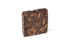 Square briquette of black Chinese Shu Pu-erh tea isolated Royalty Free Stock Photography