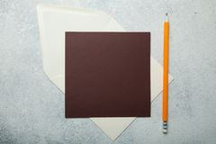 A square brown letter on a white vintage background royalty free stock photo