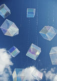 Square bubbles. Installation art piece with floating perspex houses suspended on wire to look like polygonal soap bubbles. with fluffy white clouds and Royalty Free Stock Image