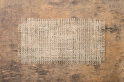 Square of burlap on wooden background. vintage texture. vintage Royalty Free Stock Photos