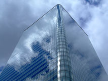 Square business building. Blue glass square building with round corners stock photography