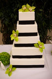 Square cake. Five tier white and purple square wedding cake Stock Photography