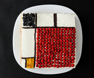 Square cake on a black background. Mondrian cake Royalty Free Stock Image
