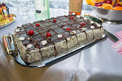 Square cake with cherries Stock Image
