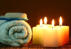 Square candle with blue towel and pumice stone Stock Images