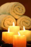 Square candles before towel Royalty Free Stock Photography