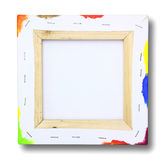Square canvas on a stretcher, paint on edge. Square canvas on a stretcher, acrylic paint on edge on white Royalty Free Stock Photography