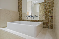 Square ceramic hand wash basin. Bathroom with square ceramic hand wash basin and mosaic tiles Stock Image