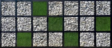Square check pattern of grass and stone wall Royalty Free Stock Photography