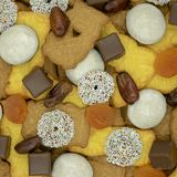 Square Christmas background made of different sorts of Christmas. Cookies, sweets, dates and dried apricots View from above stock photo