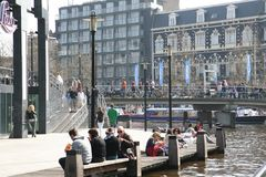Square in the city. People relax near the water and in the cafe. A warm day in the city. stock image