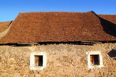 Square clay roof tiles house in Pyrenees Spain Royalty Free Stock Photography