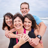 Square close up of happy family all smiling towards camera Royalty Free Stock Image