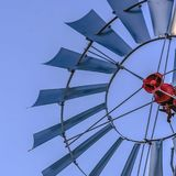 Square Close up of the multiple blades of a windpump with clear blue sky background royalty free stock images