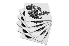 Square coasters. Stack of white square protective plastic coasters with black drawings on white background Stock Photography