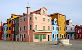 Square and colored houses in Burano in the municipality of Venice in Italy Stock Photos