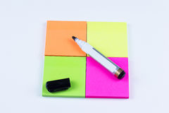 Square of colored sticky note with marker pen Royalty Free Stock Photo