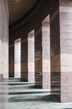 Square columns in a modern building lined with tiles Royalty Free Stock Photography