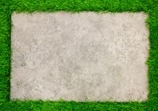 Square concrete plate on green grass background Royalty Free Stock Photo