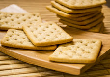 Square crackers. Stack of square crackers close-up on wooden mat Stock Image