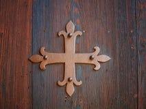 Square Cross. On wooden door Stock Image