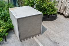 Square cube speaker for outdoor music. Monitor speaker in garden. Square cube speaker for outdoor music. Monitor speaker in a garden stock images