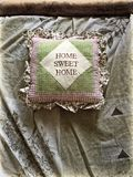 Square cushion with words Home sweet home Royalty Free Stock Photography