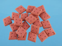 Square  dog biscuits on a blue background Royalty Free Stock Photo