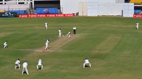 Field Setup in Ranji Trophy Cricket Match Royalty Free Stock Photo