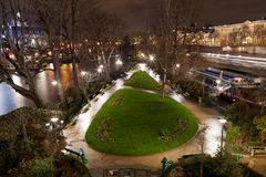 Square du Vert-Galant in Paris. Square du Vert-Galant on Ile de la Cite in Paris at night royalty free stock photography