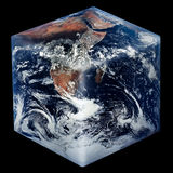Square Earth. Cube-shaped Planet Earth isolated on black Stock Images