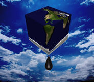 Square earth oil. Square earth drips oil with sky background Stock Photo