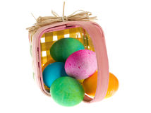 Square Easter basket with colorful dyed eggs Stock Images