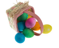 Square Easter basket spilling dyed eggs Royalty Free Stock Photo