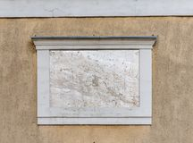 Square empty signboard. Horizontal closeup of square empty signboard on a building with classic architecture royalty free stock image