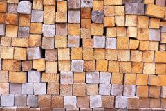 Square ends of a stack of wood blocks background Stock Photos