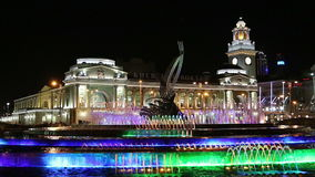 Square of Europe, Animated fountain and Kiyevskaya railway station  lit at night, Moscow, Russia stock video