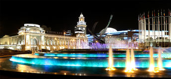 Square of  Europe, Animated fountain and Kiyevskaya railway station  lit at night, Moscow, Russia Royalty Free Stock Image